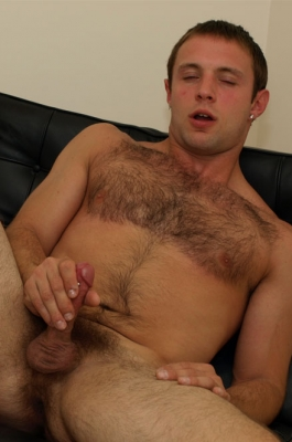 Rugged guy masturbating his big cock